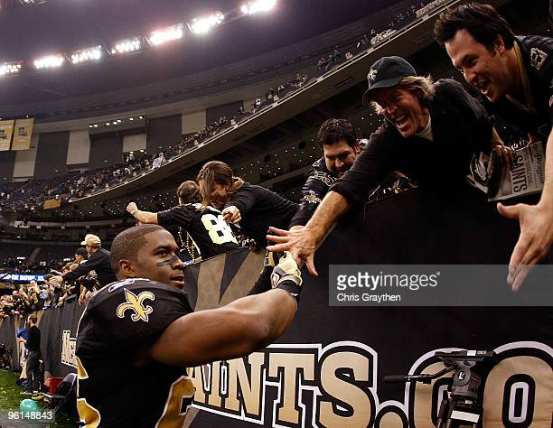 Reggie Bush of the New Orleans Saints celebrates with fans after the Saints won 3128 against the Minnesota Vikings during the NFC Championship Game...