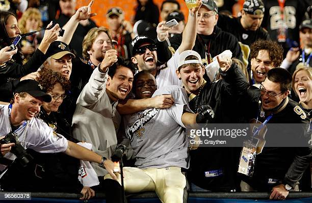 Reggie Bush of the New Orleans Saints celebrates with fans after defeating the Indianapolis Colts during Super Bowl XLIV on February 7, 2010 at Sun...