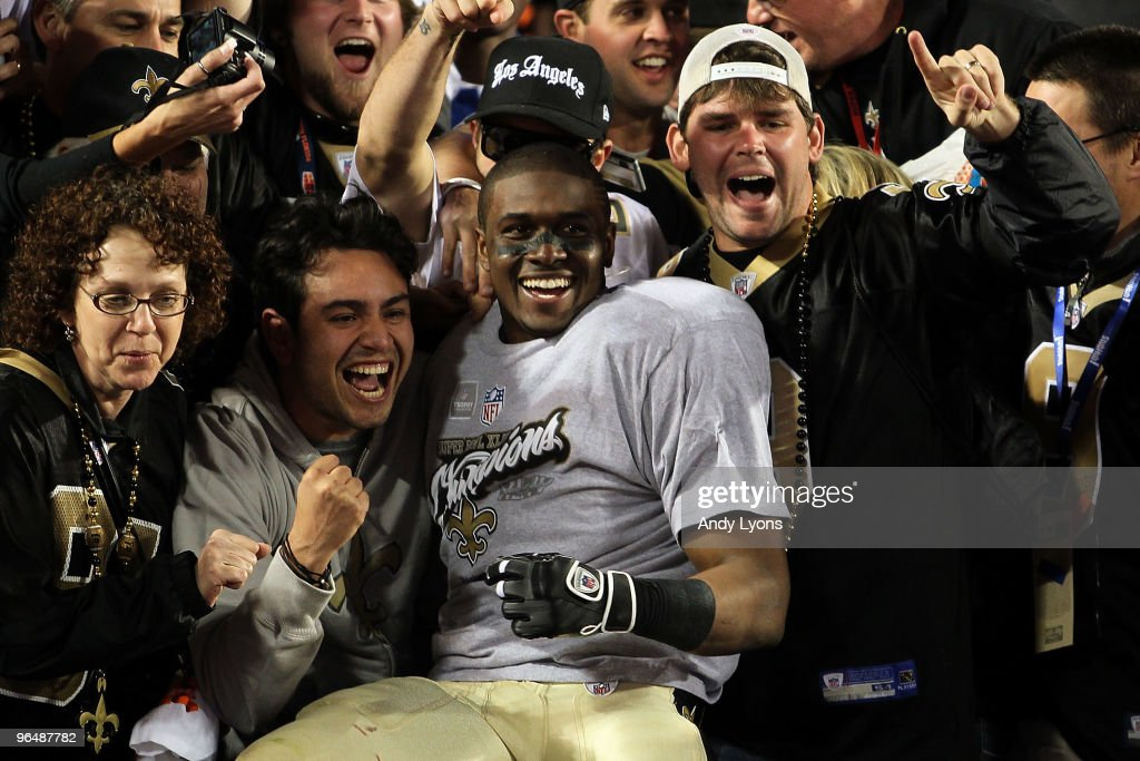 Reggie Bush #25 of the New Orleans Saints celebrates with fans in the stands after defeating the Indianapolis Colts during Super Bowl XLIV on February 7, 2010 at Sun Life Stadium in Miami Gardens, Florida.