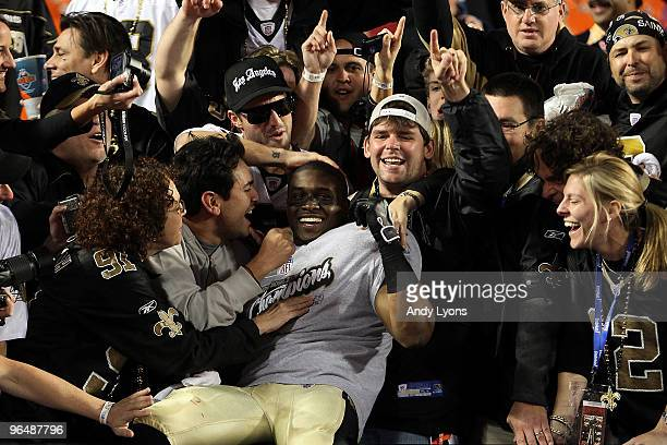 Reggie Bush of the New Orleans Saints celebrates with fans in the stands after defeating the Indianapolis Colts during Super Bowl XLIV on February 7,...