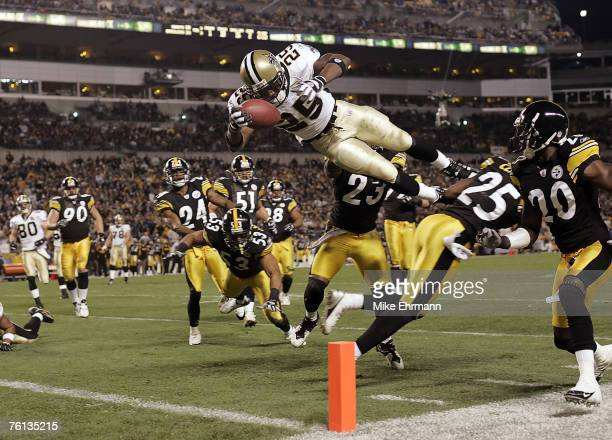 RB Reggie Bush of the New Orleans Saints dives into the endzone for a touchdown during a game against the Pittsburgh Steelers at Heinz Field in...