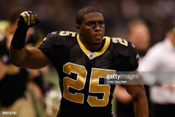 Reggie Bush of the New Orleans Saints gestures as he runs off the field at hlaftime against the Arizona Cardinals during the NFC Divisional Playoff...