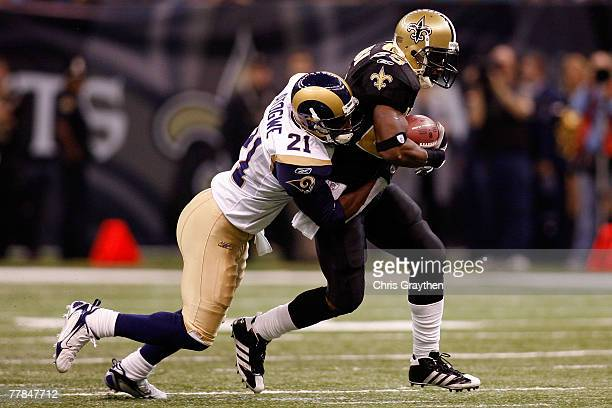 Reggie Bush of the New Orleans Saints is tackled by Oshiomogho Atogwe of the St Louis Rams at the Louisiana Superdome November 11 2007 in New Orleans...