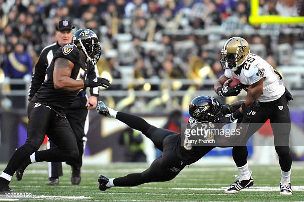 Reggie Bush of the New Orleans Saints is tackled by Tavares Gooden of the Baltimore Ravens at MT Bank Stadium on December 19 2010 in Baltimore...