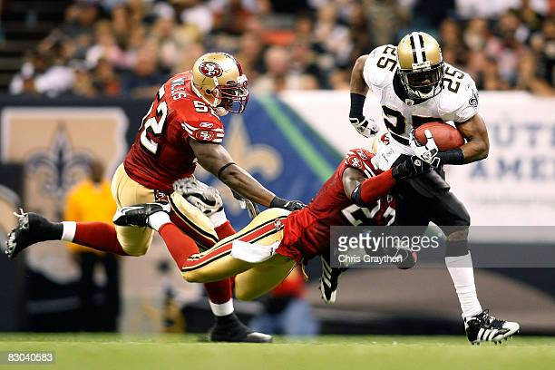 Reggie Bush of the New Orleans Saints is tackled by Walt Harris of the San Francisco 49ers on September 28 2008 at the Superdome in New Orleans...