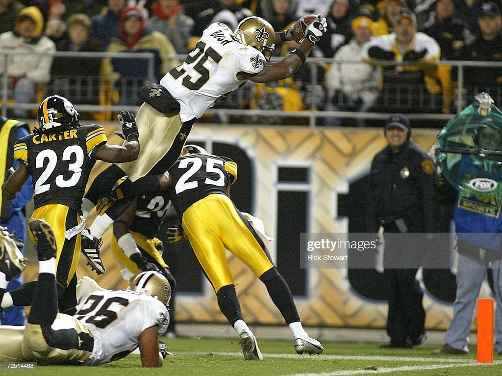 Reggie Bush #25 of the New Orleans Saints jumps for the end zone to score a touchdown over Ryan Clark #25 of the Pittsburgh Steelers on November 12, 2006 at Heinz Field in Pittsburgh, Pennsylvania.