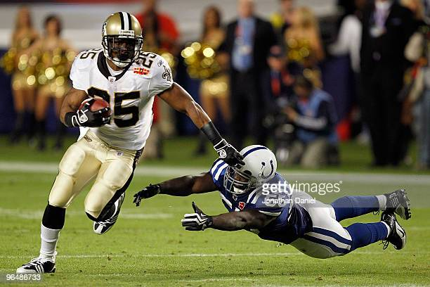 Reggie Bush of the New Orleans Saints runs with the ball against Clint Session of the Indianapolis Colts during Super Bowl XLIV on February 7, 2010...