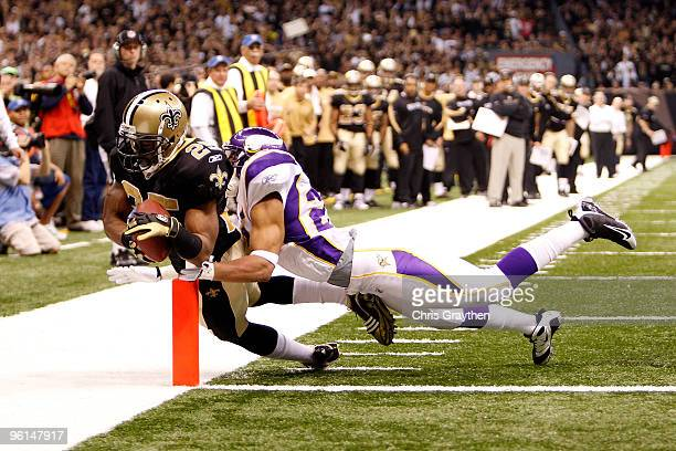 Reggie Bush of the New Orleans Saints scores a 5yard touchdown reception in the 4th quarter against Tyrell Johnson of the Minnesota Vikings during...