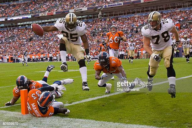 Reggie Bush of the New Orleans Saints scores a touchdown against the Denver Broncos at Invesco Field at Mile High on September 21, 2008 in Denver,...