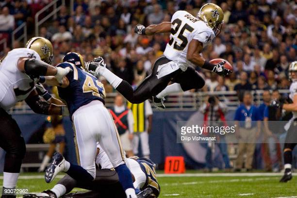 Reggie Bush of the New Orleans Saints scores a touchdown against the St. Louis Rams at the Edward Jones Dome on November 15, 2009 in St. Louis,...