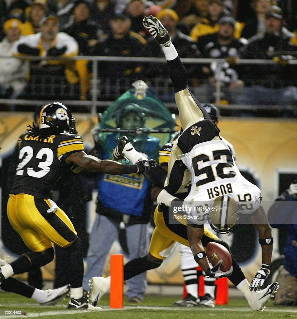 Reggie Bush #25 of the New Orleans Saints scores a touchdown on a reverse ahead of Tyrone Carter #23 of the Pittsburgh Steelers on November 12, 2006 at Heinz Field in Pittsburgh, Pennsylvania.