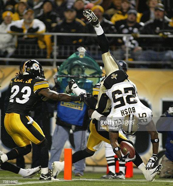 Reggie Bush of the New Orleans Saints scores a touchdown on a reverse ahead of Tyrone Carter of the Pittsburgh Steelers on November 12 2006 at Heinz...