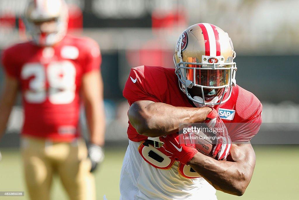 Reggie Bush #23 of the San Francisco 49ers runs drills during a practice session at Levi's Stadium on August 7, 2015 in Santa Clara, California.