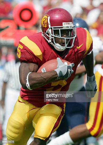 Reggie Bush of the USC Trojans carries the ball during the game with the Arizona Wildcats at the Los Angeles Colliseum on October 8 2005 in Los...