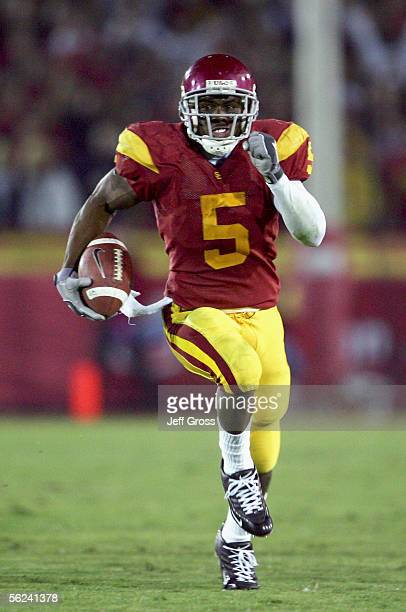 Reggie Bush of the USC Trojans carries the ball during the game with the Fresno State Bulldogs at the Los Angeles Memorial Coliseum on November 19...