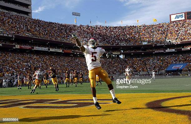 Reggie Bush of the USC Trojans celebrates after scoring his second touchdown against the Arizona State Sun Devils on October 1 2005 at Sun Devil...