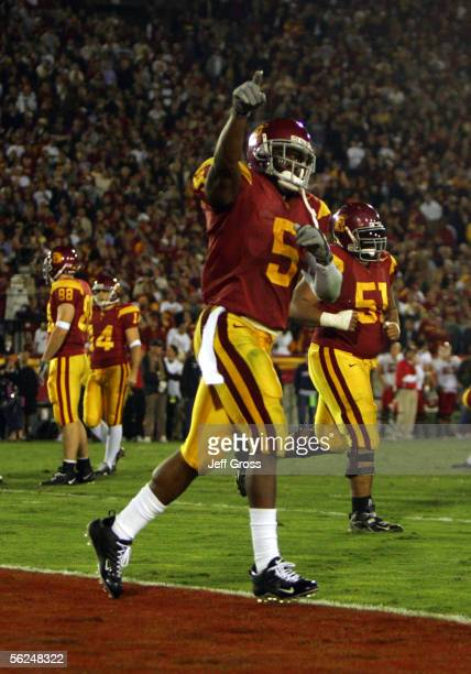 Reggie Bush of the USC Trojans celebrates during the game with the Fresno State Bulldogs at the Los Angeles Memorial Coliseum on November 19, 2005 in...