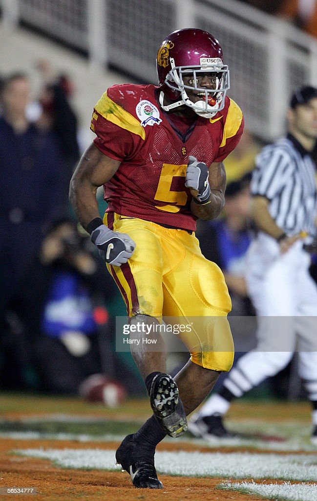 Reggie Bush #5 of the USC Trojans celebrates in the end zone after scoring a 26 yard touchdown in the fourth quarter of the BCS National Championship Rose Bowl Game against the Texas Longhorns at the Rose Bowl on January 4, 2006 in Pasadena, California. Texas defeated USC