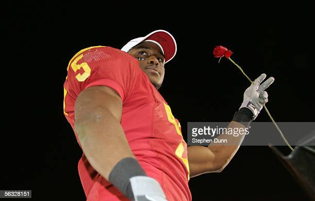Reggie Bush of the USC Trojans holds a rose in hopes of playing in the Rose Bowl following USC's 66-19 win against the UCLA Bruins December 3, 2005...