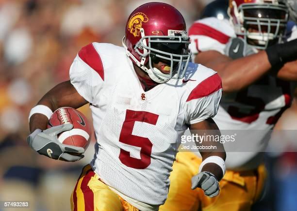 Reggie Bush of the USC Trojans runs with the ball against the California Golden Bears at Memorial Stadium on November 12th, 2005 in Berkeley,...