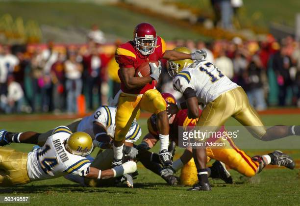 Reggie Bush of the USC Trojans runs with the ball against the UCLA Bruins during the game on December 3, 2005 at the Los Angeles Memorial Coliseum in...