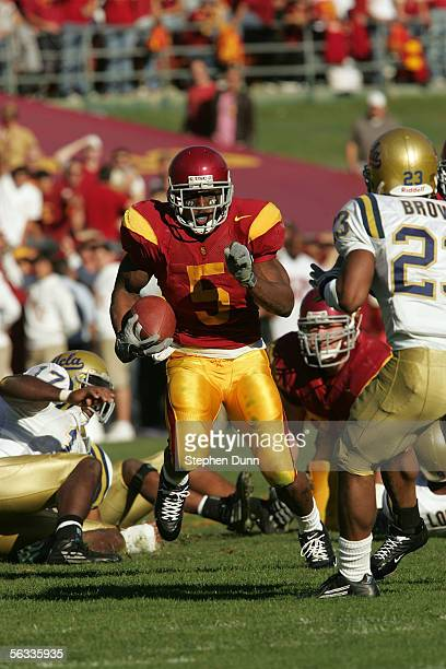 Reggie Bush of the USC Trojans rushes the ball against the UCLA Bruins December 3, 2005 at the Los Angeles Memorial Coliseum in Los Angeles,...