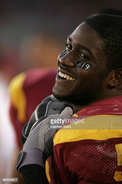 Reggie Bush of the USC Trojans smiles on the sideline against the UCLA Bruins December 3, 2005 at the Los Angeles Memorial Coliseum in Los Angeles,...