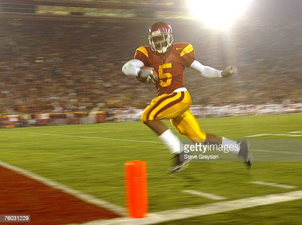 Reggie Bush of USC heads for the endzone on 42 yard touchdown run against the Stanford Cardinal in the firsthalf of their contest at the Los Angeles...