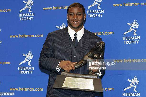 Reggie Bush University of Southern California tailback holds the Heisman Trophy during the 2005 Heisman Trophy presentation at the Hard Rock Cafe in...