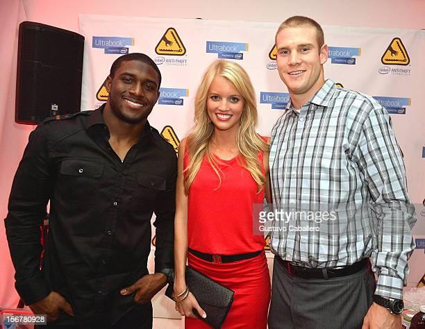 Reggie BushLauren Tannehill and Ryan Tannehill attends TigerDirectcom And Intel's Holiday Tech Bash on November 20 2012 in Miami Florida