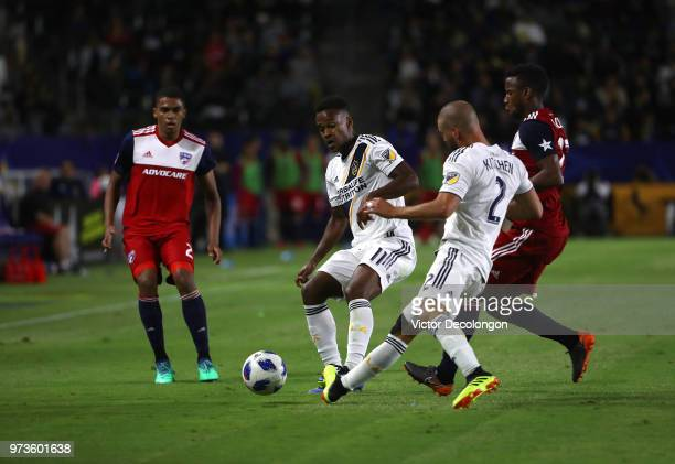 Reggie Cannon of FC Dallas Ola Kamara and Perry Kitchen of Los Angeles Galaxy and Kellyn Acosta of FC Dallas vie for the ball in the first half...