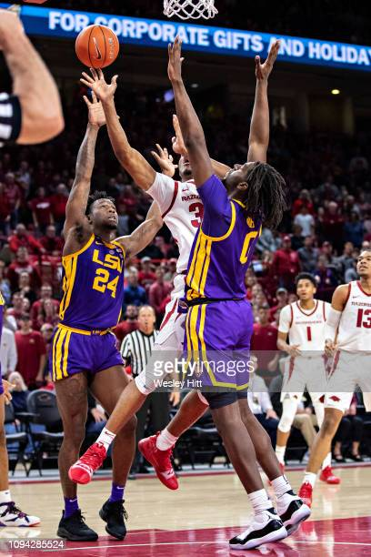 Reggie Chaney of the Arkansas Razorbacks goes up for a shot against Naz Reid of the LSU Tigers at Bud Walton Arena on January 12 2019 in Fayetteville...