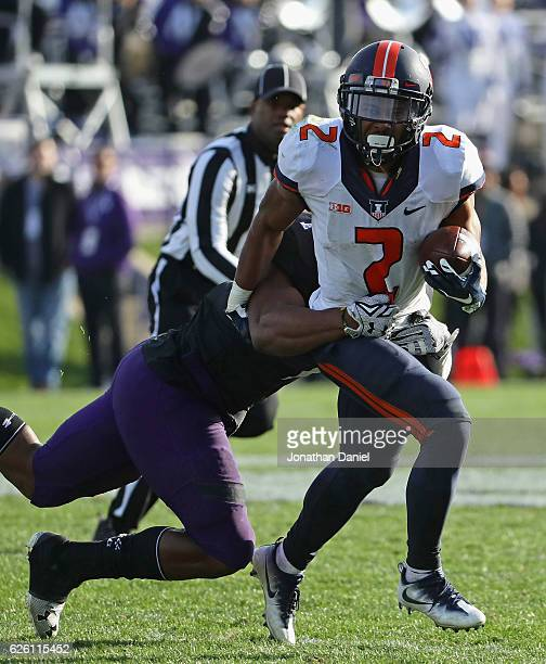 Reggie Corbin of the Illinois Fighting Illini is grabbed by Anthony Walker Jr. #1 of the Northwestern Wildcats at Ryan Field on November 26, 2016 in...