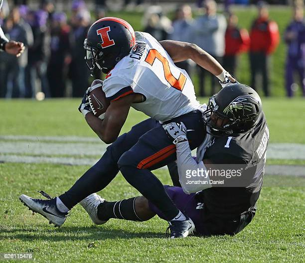 Reggie Corbin of the Illinois Fighting Illini is tackled by Anthony Walker Jr. #1 of the Northwestern Wildcats at Ryan Field on November 26, 2016 in...