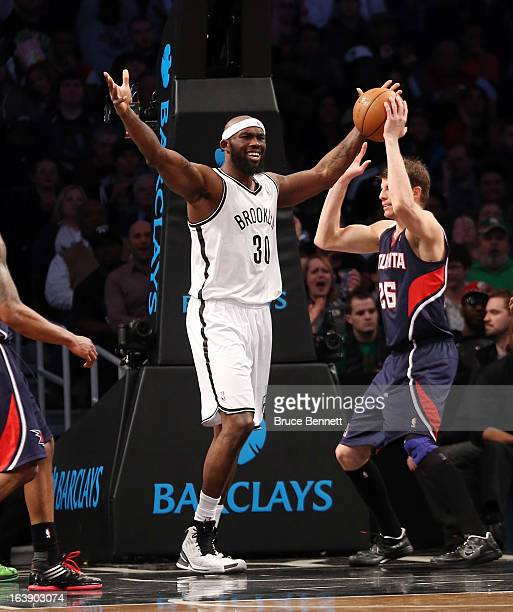 Reggie Evans of the Brooklyn Nets celebrates his second quarter basket against the Atlanta Hawks at the Barclays Center on March 17 2013 in New York...