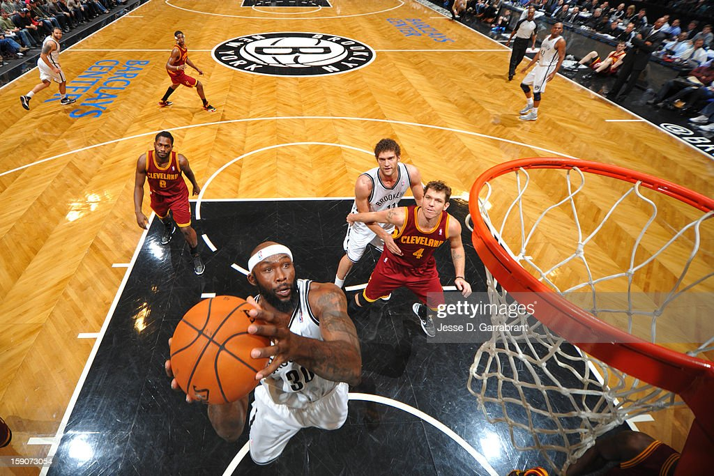 Reggie Evans #30 of the Brooklyn Nets drives to the basket against the Cleveland Cavaliers at the Barclays Center on December 29, 2012 in Brooklyn, New York.