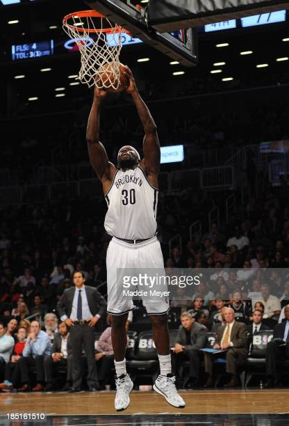 Reggie Evans of the Brooklyn Nets dunks the ball during the second half against the Miami Heat at Barclays Center on October 17 2013 in the Brooklyn...
