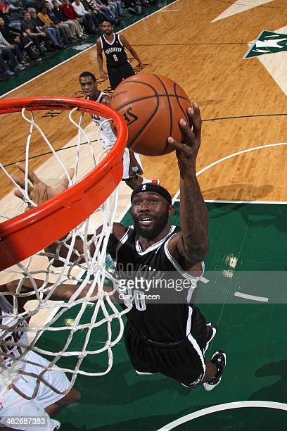 Reggie Evans of the Brooklyn Nets going up for a layup during a game against the Milwaukee Bucks on December 7 2013 at the BMO Harris Bradley Center...