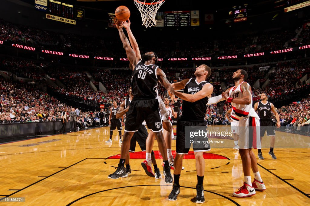 Reggie Evans #30 of the Brooklyn Nets reaches for a rebound against the Portland Trail Blazers on March 27, 2013 at the Rose Garden Arena in Portland, Oregon.