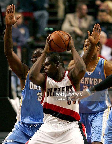 Reggie Evans of the Denver Nuggets guards Zach Randolph of the Portland Trail Blazers on January 31 2006 at the Rose Garden in Portland Oregon NOTE...