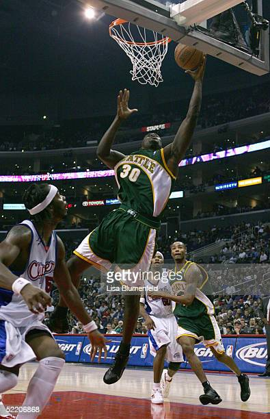 Reggie Evans of the Seattle Sonics lays up a shot against Chris Wilcox of the Los Angeles Clippers during the Clippers home opener at Staples Center...