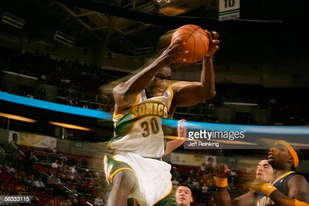 Reggie Evans of the Seattle SuperSonics rebounds in a slow shutter speed blur against the Indiana Pacers at Key Arena on December 4 2005 in Seattle...