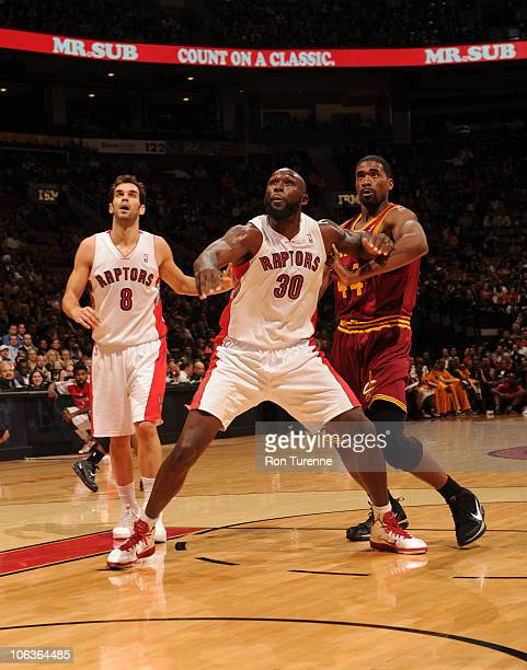 Reggie Evans of the Toronto Raptors boxes out Leon Powe of the Cleveland Cavaliers during a game on October 29 2010 at the Air Canada Centre in...