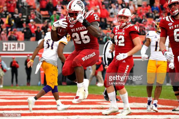 Reggie Gallaspy II of the North Carolina State Wolfpack celebrates following a fouryard touchdown run against the East Carolina Pirates in the third...