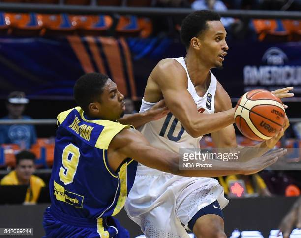 Reggie Hearn of United States fights for ball with Johnathan Gray of Virgin Islands during the FIBA Americup semi final match between US and Virgin...