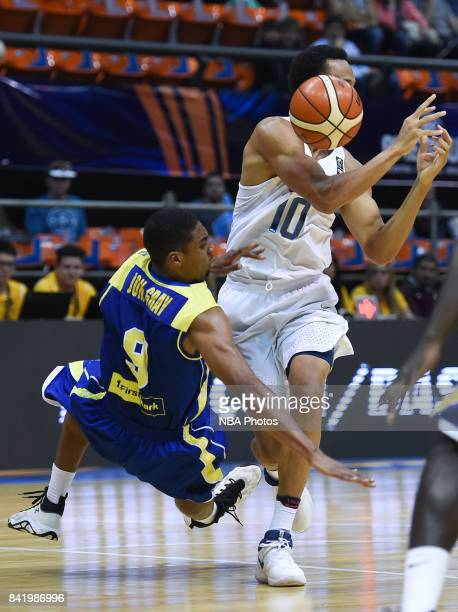 Reggie Hearn of United States fights for the ball with Johnathan Gray of Virgin Islands during the FIBA Americup semi final match between US and...
