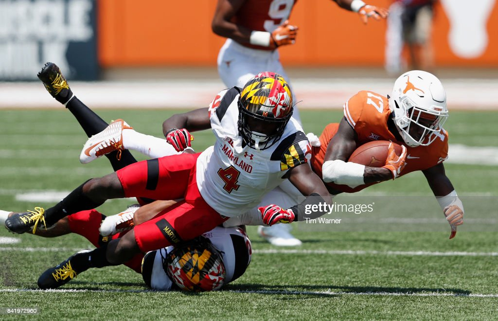 Reggie Hemphill-Mapps #17 of the Texas Longhorns is tackled by Darnell Savage Jr. #4 of the Maryland Terrapins in the third quarter at Darrell K Royal-Texas Memorial Stadium on September 2, 2017 in Austin, Texas.