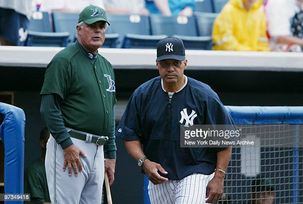 Reggie Jackson a special adviser to the New York Yankees takes the field after shaking hands with Tampa Bay Devil Rays' manager Lou Piniella as the...