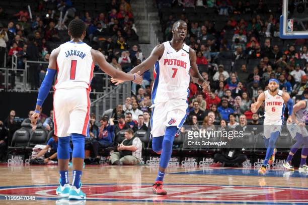 Reggie Jackson, and Thon Maker of the Detroit Pistons hi-five each other during the game against the Charlotte Hornets on February 10, 2020 at Little...