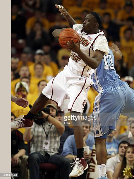 Reggie Jackson of the Boston College Eagles goes up for two as Will Graves the North Carolina Tar Heels defends on February 20 2010 at Conte Forum in...
